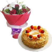 11枝紅玫瑰,2枝多頭白百合,黃鶯;綠葉間插;圓形鮮奶水果蛋糕