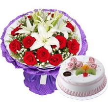 11枝精品紅玫瑰,2枝白色多頭百合,黃鶯、滿天星間插點綴;圓形水果蛋糕