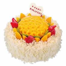 圆形水果蛋糕,时令水果铺面,外壁搭配白色巧克力屑