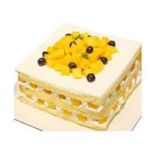 方形水果裸蛋糕,芒果中間鋪面,鮮奶、芒果夾層(兩層夾層)