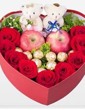 9支红玫瑰,9颗费列罗巧克力,两个苹果,两个小熊,黄莺丰满,心形礼盒包装。