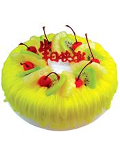 圆形鲜奶水果蛋糕,黄色奶油流苏,时令水果装饰。