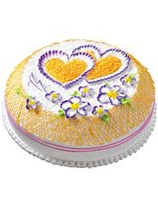 圆形鲜奶蛋糕,橙色奶油流苏,紫色鲜奶花装饰