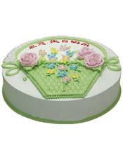 圆形鲜奶蛋糕,蛋糕上有鲜奶做成的花篮