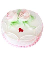 圆形鲜奶蛋糕,两朵鲜奶玫瑰花装饰