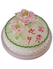 圆形鲜奶蛋糕,两朵鲜奶牡丹花装饰