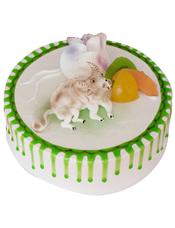 圆形鲜奶水果蛋糕,时令水果,蛋糕上做一只牛。