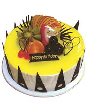 圆形鲜奶水果蛋糕,时令水果,黄色果浆,巧克力插片围圈