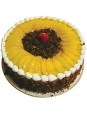 圆形水果蛋糕,中间和外围巧克力屑装饰,水果,奶油围边。