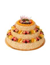 三层圆形鲜奶水果蛋糕,各色时令水果艺术装饰,果仁碎屑围边。